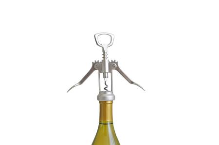 A bottle of white wine with a corkscrew. White isolate. Close-up Archivio Fotografico - 126957597