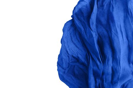Preparation for the background. Blue fabric. White isolate. Crumpled cotton. Close-up.