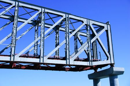 Part of the railway bridge on a concrete support. Happy against the blue sky. Stock fotó