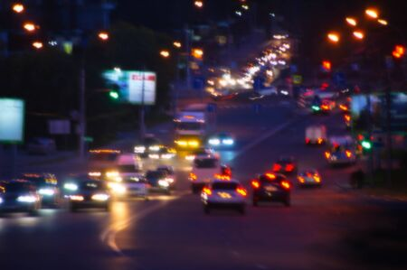 Night highway with cars in the city. Traffic. Blurred focus. Reklamní fotografie