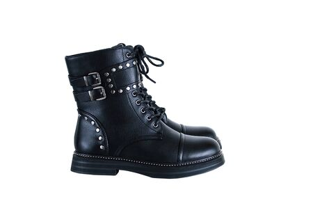 Black boot closeup with metal staves. White isolate