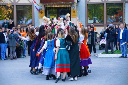Russia 10-04-2019. Open event in the Russian-German house. Dancing in national costumes in the open air.