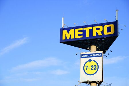 Russia 09-25-2019. Metro store advertising sign on a blue sky background.