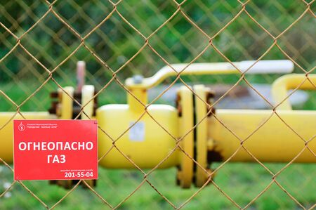 Russia 09-25-2019. Gas pipeline. Vent and piping. The inscription in Russian caution gas. Redakční