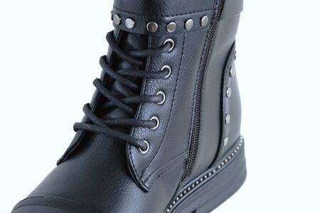 Shoelaces on black boots close-up with metal rivets. White background. Reklamní fotografie
