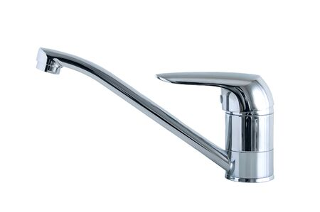Chrome plated metal faucet. White isolate.