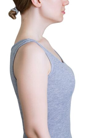 Direct posture. Caucasian woman in a gray tank top. White isolate.