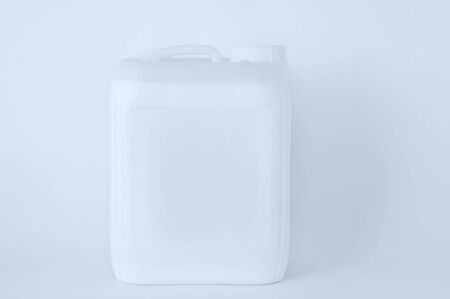 White plastic canister close-up on a white background.