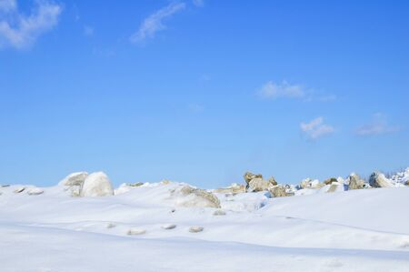 Winter landscape in the mountains. Snow against the blue sky in the afternoon. Stock fotó