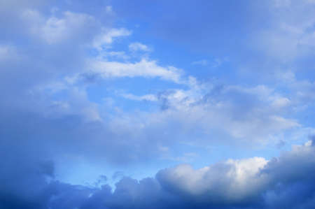 Thundercloud and clouds on blue sky at daytime outdoors.