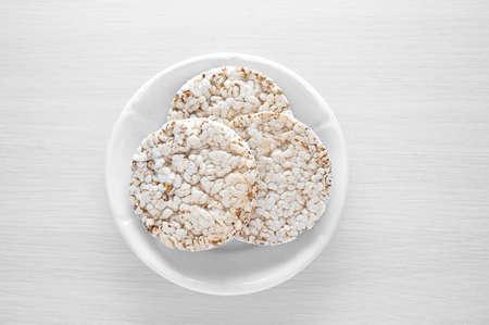 Crispy dietary bread on a white plate. Vegetarian breakfast.