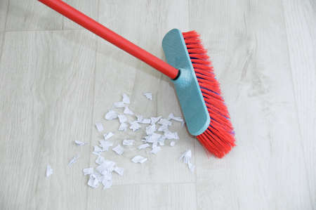 Sweep the floor with a brush. Indoor cleaning close-up.