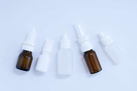 Bottles with drops for nose and eyes close-up. White background. Banque d'images