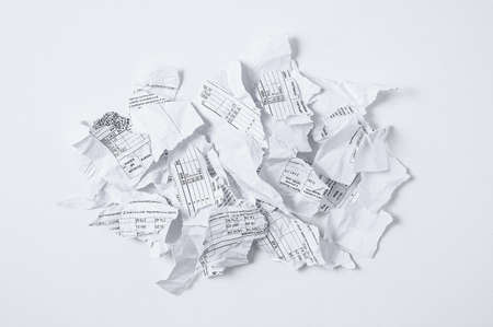 Torn paper bill of payment. White background.