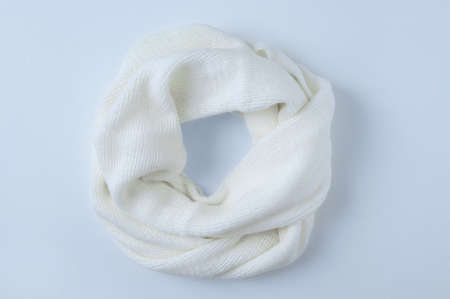 A winter personal accessory. Beige scarf snood. White background. Banque d'images