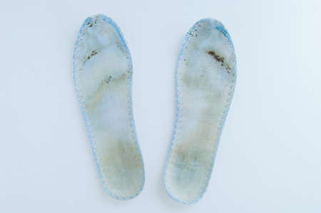 Dirty shoe insoles on a white background close-up. Banque d'images - 159212475