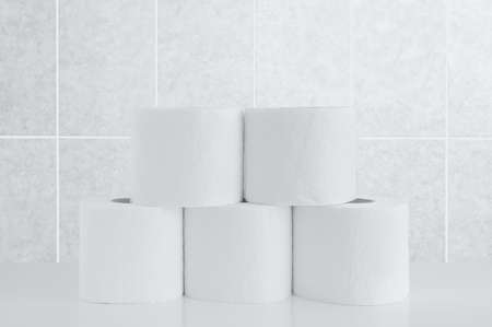Rolls of toilet paper on a tile background.