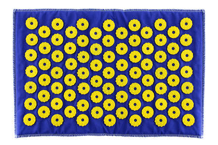 Blue massage mat with yellow plastic needles. White isolate. 스톡 콘텐츠
