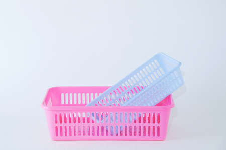 Two plastic boxes for home pink blue on a white background.