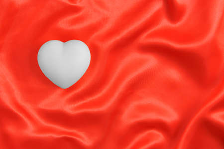 White heart on red satin fabric. Valentines Day. 스톡 콘텐츠