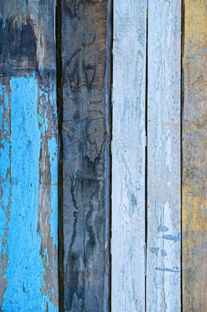 Vertical texture of old painted wooden boards close-up.