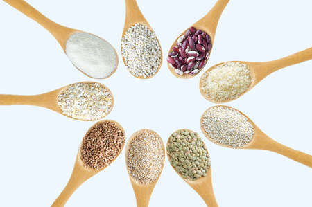Cereals in a spoon in a circle on a white background close-up.