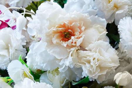 Bouquet of white artificial flowers park rose close-up.