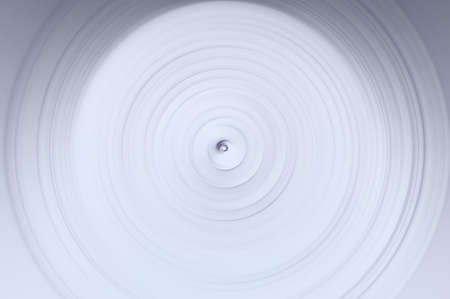 Abstract background of swirling sphere in gray-white colors.