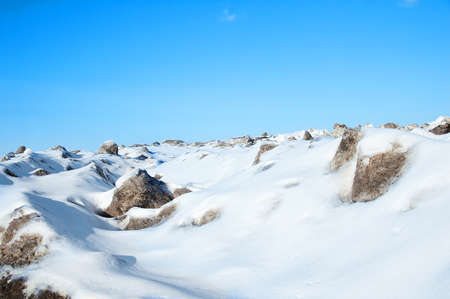 Winter landscape in the afternoon outdoors in the mountains against the blue sky. 스톡 콘텐츠
