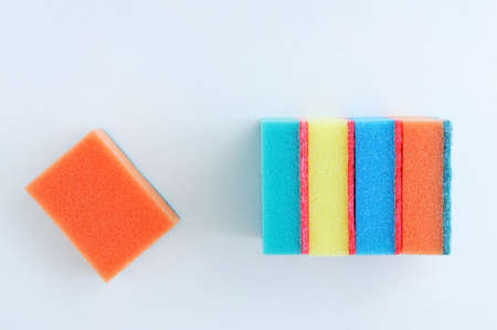 Multi-colored foam sponges for washing dishes on a white background. Stock Photo