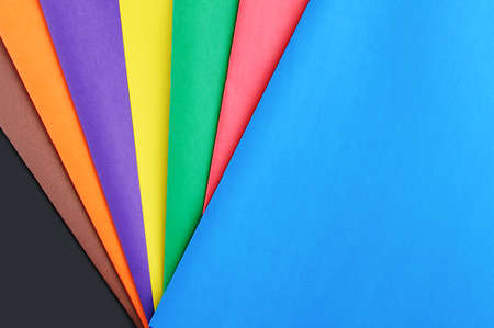 Multicolored sheets of colored paper close-up. Stationery.