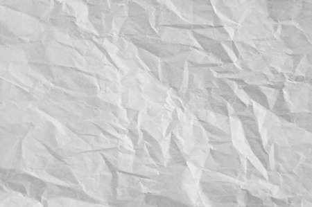 Gray crumpled sheet of rough paper closeup texture and blank background. 스톡 콘텐츠