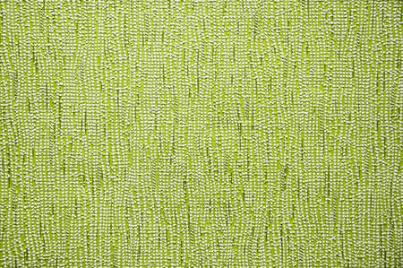 Green abstract texture wallpaper background with vertical curved lines.