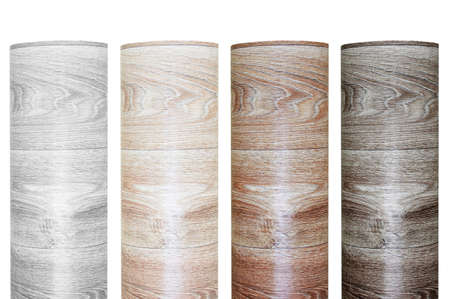 Four samples of rolled linoleum roll with wood texture. White isolate.
