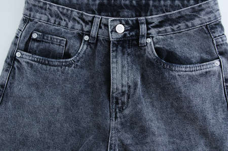 Gray buttoned jeans close-up front view. Standard-Bild