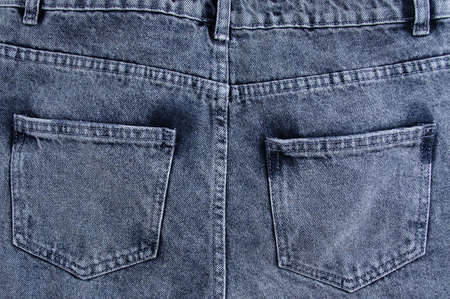 Gray jeans with pockets close-up back view. Denim background. Standard-Bild