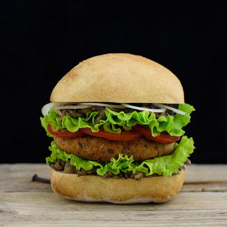 vegetarian hamburger: Vegan burger on rustic wooden table.