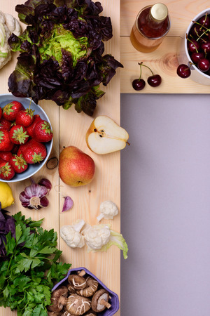 gastronome: Organic food background. Fresh vegetables and fruits on wooden store shelves. Top view, copy space.