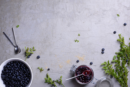 Blueberry background. Ripe and juicy fresh picked blueberries top view, copy space.