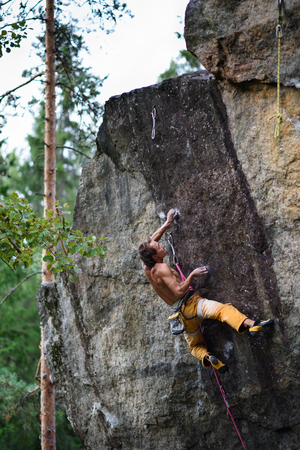 struggle: Extreme sport climbing. Rock climber struggle for success. Power, achievement, struggle, success.