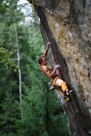 struggle: Extreme sport climbing. Rock climber struggle for success. Copy space. Stock Photo