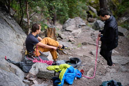 ascent: Rock climbing team prepare a challenging ascent. Climber and belayer. Stock Photo