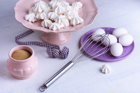 French dessert - meringues. Bakery products. Close up confectionery ingredients. Pavlova. Stock Photo