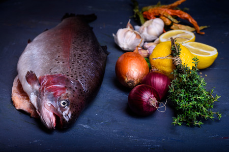 Preparation of fresh salmon with cooking ingredients. Fish dish.