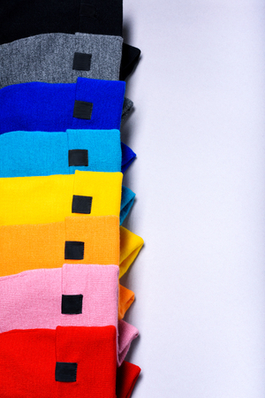 Colorful clothes items. Knitted beanie hats.Top view, copy space. Advertising discount mock up.