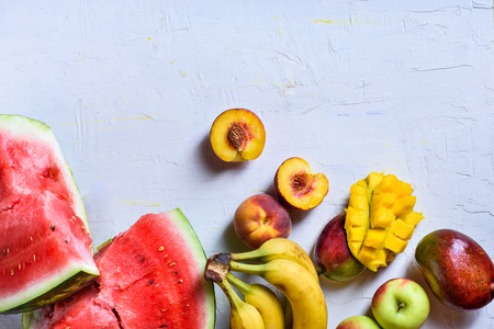 Fresh tropical fruits. Raw organic food background.Top view, copy space.