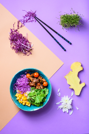 Asian Poke bowl with rice, meat, beef and ingredients.  Diet food. Top view. Flat lay. Banner free space.