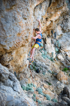Rock climbing, man on a challenging cliff, lead climbing. Outdoor active lifestyle. Travel destination Kalymnos, Greece. Reklamní fotografie