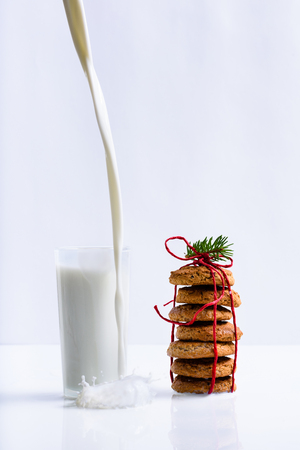 Stack of homemade Cookies and a glass of milk. Healthy snack. White background. Reklamní fotografie