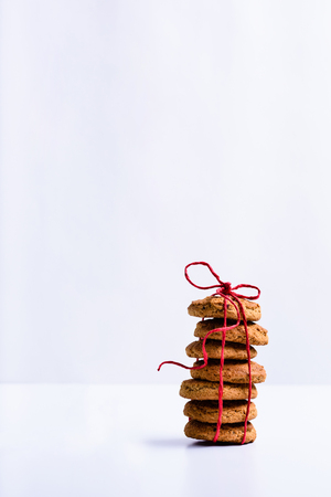 Homemade oatmeal cookies on white background. Copy space.